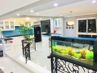 KITCHEN WITH BALCONY AND VIEW.