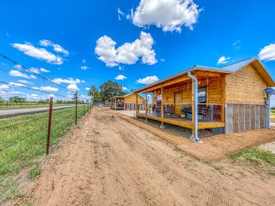 Photo for Two side-by-side cabins w/ private hot tubs & furnished front porches