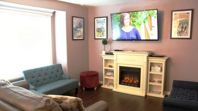 Cozy up to the fireplace and watch your favorite Netlix show on the smart TV