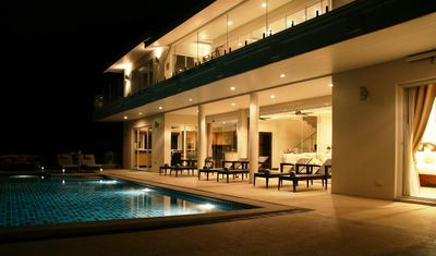 Front view of house facing sea at night