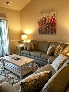 living room with queen sleeper sofa, love seat and arm chair.