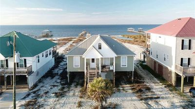 Photo for Tropical Paradise - Newly remodeled 4 Bedroom Beach House on a  Sandy Bay Beach