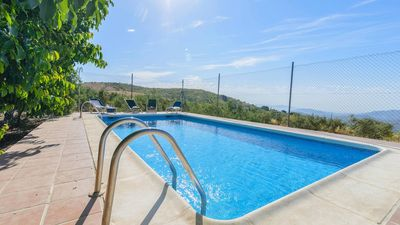 Photo for Typical holiday villa in Malaga province overlooking the hills