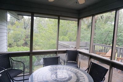 """Screened porch and deck overlooking lagoon view - our favorite """"room""""."""