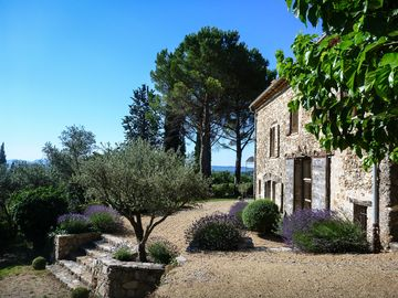 18th century restored stone house in a large mature garden with 360 degree views