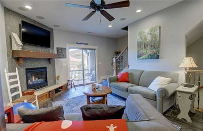 """Main Living Room - Comfortable seating, beautiful views from balcony, gas fireplace, 55"""" HD TV, ceiling fan"""