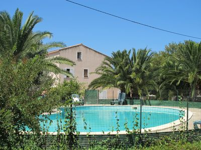 Photo for 45 m2 apartment in comfortable villa with aircon, pool, 1km from the beach