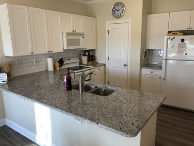 Kitchen with new granite counter top, sink and faucet