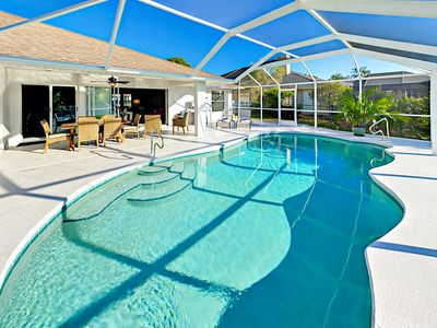 Photo for Sunset View Canalfront Retreat w/Lanai, Heated Pool & Boat Dock - Gulf Access