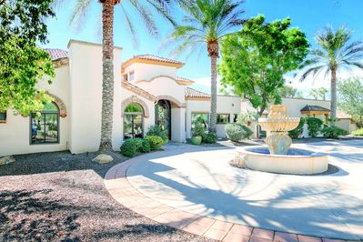 Exterior - Welcome to Paradise Valley, where a tropically landscaped courtyard greets you upon arrival.