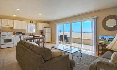 Photo for Cute lower oceanfront unit located within walking distance to the Newport Pier.