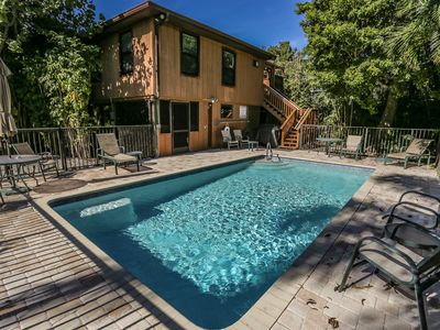 Photo for Tropical Pool Home Nestled Amidst the Trees Walk to the Beach & Times Square