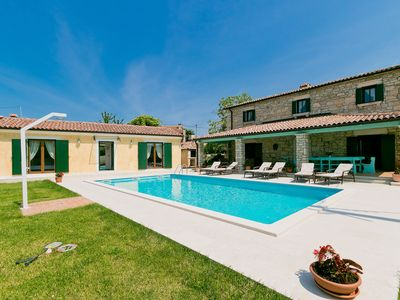 Photo for This 5-bedroom villa for up to 12 guests is located in Porec and has a private swimming pool, air-co