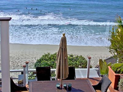 Photo for Oceanfront Cottage is on the sand in heart of Laguna Beach Village