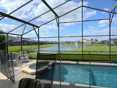 Photo for Orlando Disney Area Vacation Pool Home with Stunning Lakefront View, Outdoor Spa, Games Room and Free WIFI!