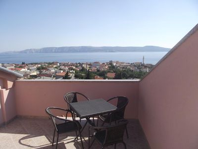 Photo for Two bedroom apartment with terrace and sea view Novi Vinodolski (A-5479-d)