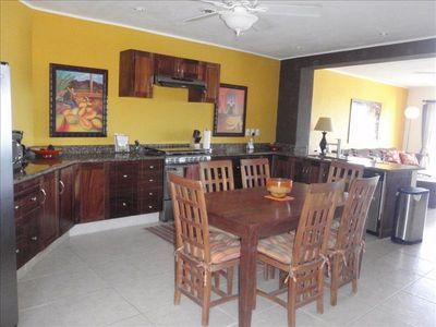 Kitchen and dining area with S/S appliances & granite countertops throughout