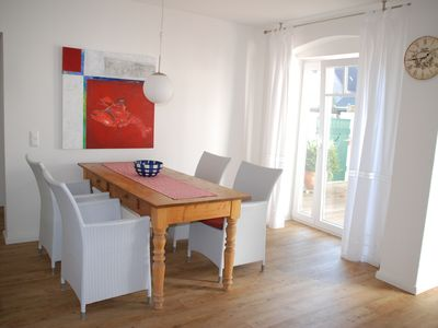 Photo for Modern and lovingly decorated apartment right in the city and on the beach