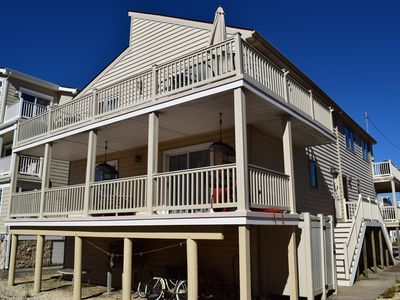 Photo for SAND & ENDLESS WAVES!!!  ONLY 6TH position from the beach in one of the hottest beach block areas in Sea Isle. This front to back townhouse (south unit) offers great privacy, ocean views, and is just steps to the promenade,