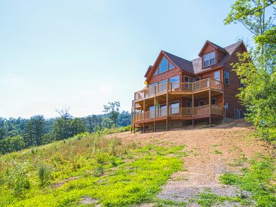 Photo for Large cabin w/ a private hot tub, gas fireplace, & game room - close to town!