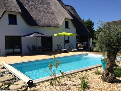 Photo for Contemporary thatched cottage with private pool