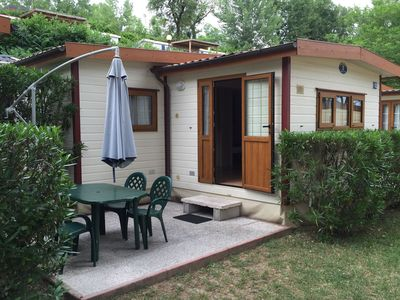 Photo for Carefully furnished chalet with air conditioning located on a small park on the banks of Lake Garda