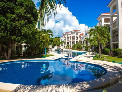 Photo for Spacious, quiet and safe condo one block from the beach in Playacar