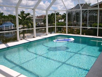 Photo for Family Friendly  Home, with Canal Views,  Pool  Screened Lanai, Free WIFI