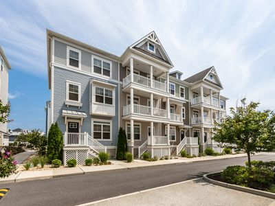 Photo for NEW LISTING! Beautifully townhome w/ furnished deck, shared pool - walk to beach