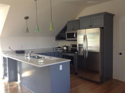 Modern kitchen with all appliances and quartz countertops.