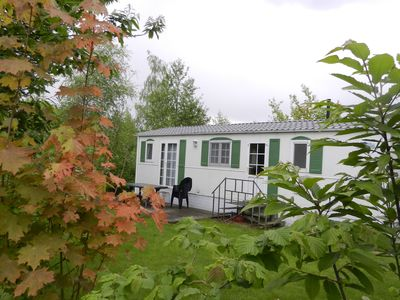 Photo for Simply furnished chalet located on a beautiful natural holiday park