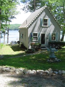 3 BR waterfront cottage quiet lake steps from dock, beach, and swim raft.