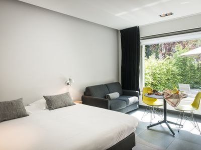 Photo for Quietly located luxury one-room flat on the ground floor with garden and free private parking