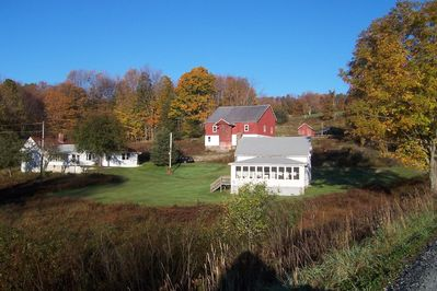 2 farmhouses next to each other, barn between