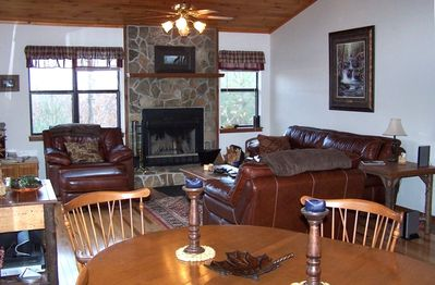 Living Room with Wood burning stone fireplace.