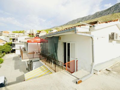 Photo for One bedroom apartment with balcony and sea view Dugi Rat, Omiš (A-11483-a)