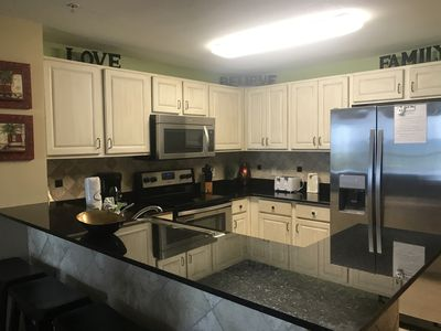 Upgraded kitchen with stainless steel and granite
