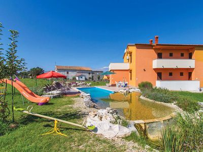 Photo for This 6-bedroom villa for up to 14 guests is located in Pula and has a private swimming pool, air-con