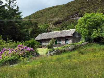 Photo for Traditional thatched cottage in exceptional location, set on a hillside facing the morning sun…