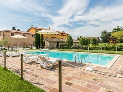 Photo for Farmhouse Il Principino with pool, children's playground and bicycles in the Marche - apt. Girasole