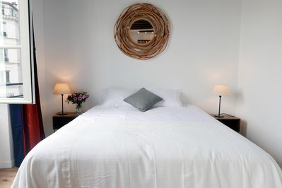 Apt. COSY2 - Latin Quarter -Bedroom1 offers a comfortable bed, storage & window