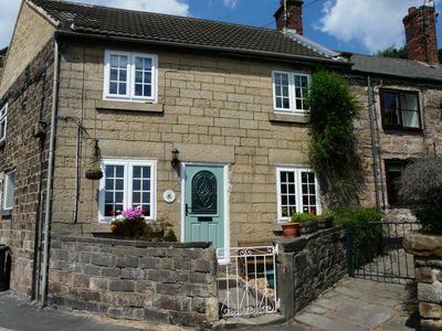 Photo for Traditional stone cottage in award winning market town on edge of peak district