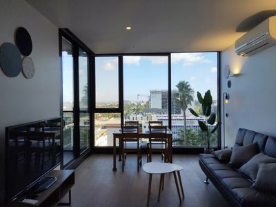 Photo for Modern & Stylish Apartment in the heart of Melbourne| Pool, Gym, Sauna
