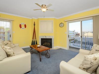 Photo for Bright, comfy 2 bedroom condo with WiFi and an outdoor pool located midtown on the bayside and just 2 blocks to the beach!