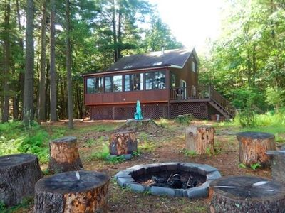 Photo for Secluded Lakehouse Retreat: Vintage Rustic Lakefront on 5 Private Wooded Acres