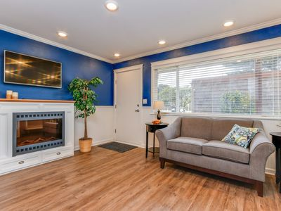 Photo for Modern & colorful dog-friendly condo right next to beach!