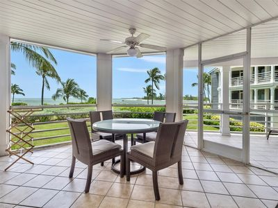 Photo for Beautiful bay, sound and Gulf Views. Private setting with pool, hot tub, tennis and beach access