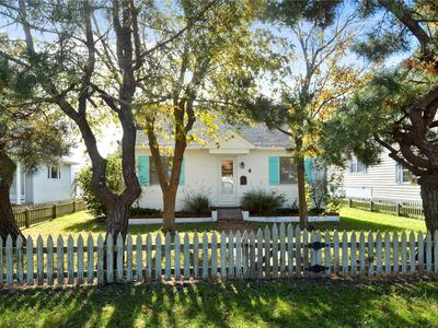 Photo for FREE DAILY ACTIVITIES INCLUDED!!! Classic beach vacation cottage located directly on the canal and is the perfect getaway for family and friends!