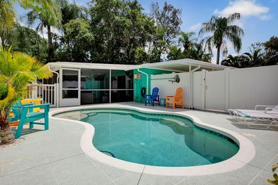 Private Heated Salt Water Pool with Sunning Deck, two benches and Jacuzzi jets.