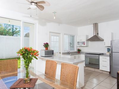 Photo for Casa Blanca- Cozy townhouse with shared pool, 10 minutes from beaches! 2BR + Den